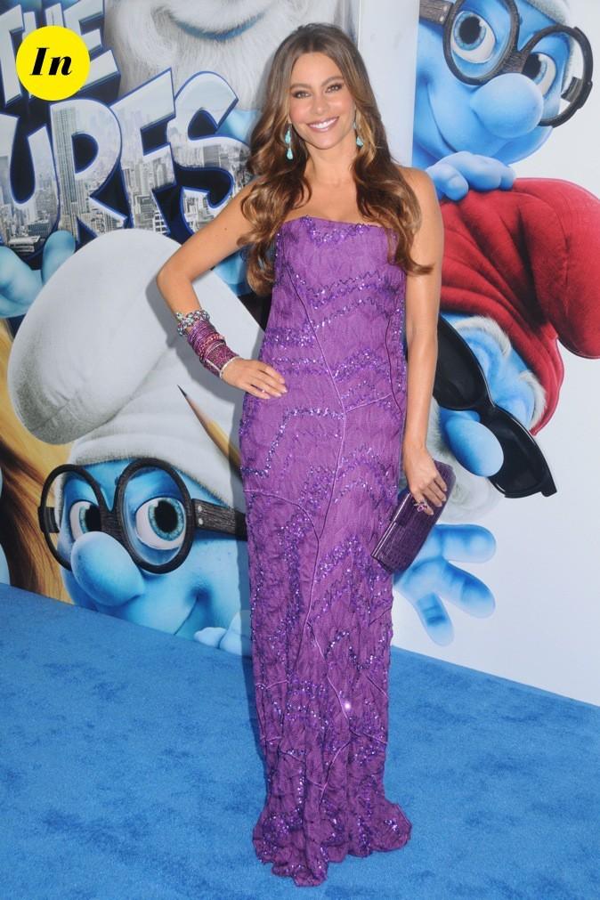 On adore sa longue robe violette !