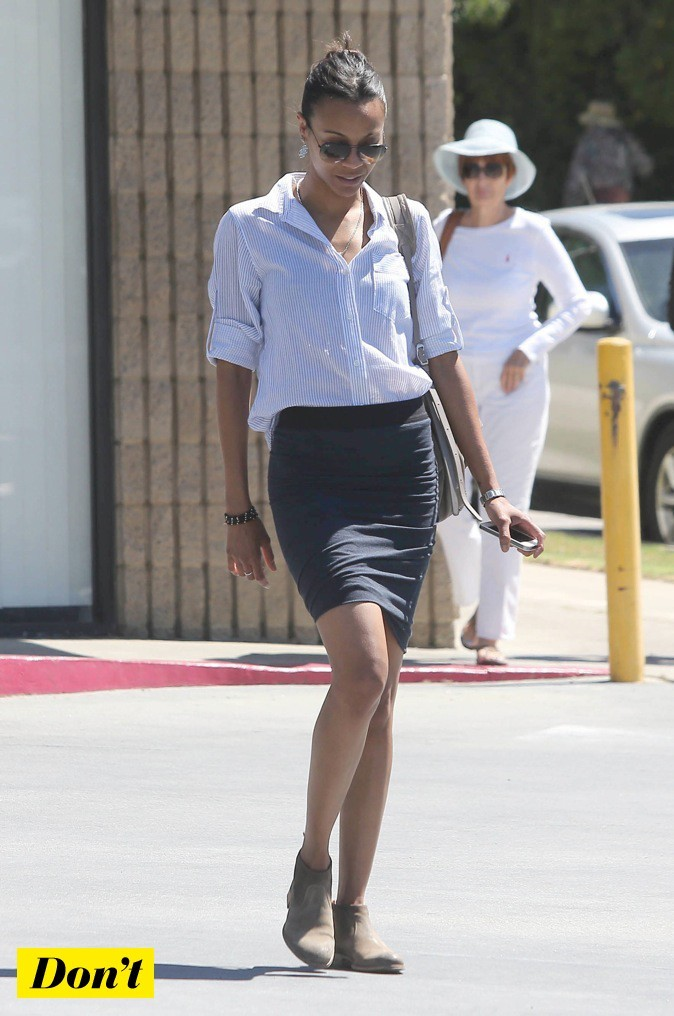 Zoe Saldana associe ses bottes à une jupe moulante !
