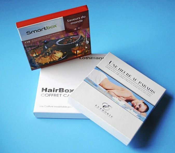 Coffret cadeau Saveurs du monde, Smartbox 49,90 € - Coffret cadeau HairBox, Lothmann 46 € - Coffret cadeau Une heure au paradis, Euphorie, 99€