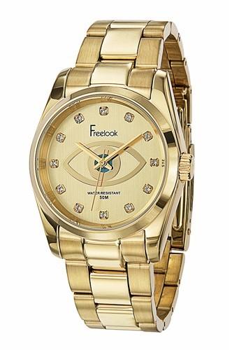 Bracelet en acier doré, Freelook, 149 €.
