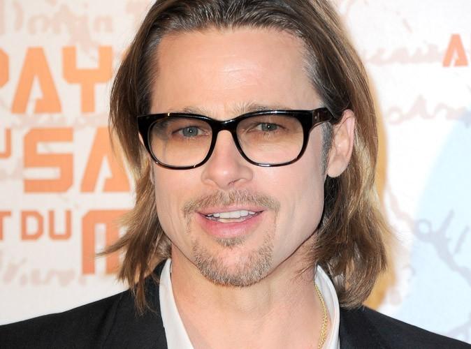 Brad Pitt : il offre une guitare électrique et un ampli à Maddox !