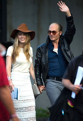 Amber Heard et Johnny Depp à Boston le 21 juillet 2014