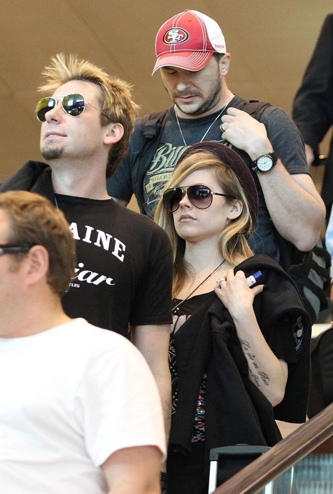 Chad Kroeger et Avril Lavigne à l'aéroport de Sydney le 23 novembre 2012