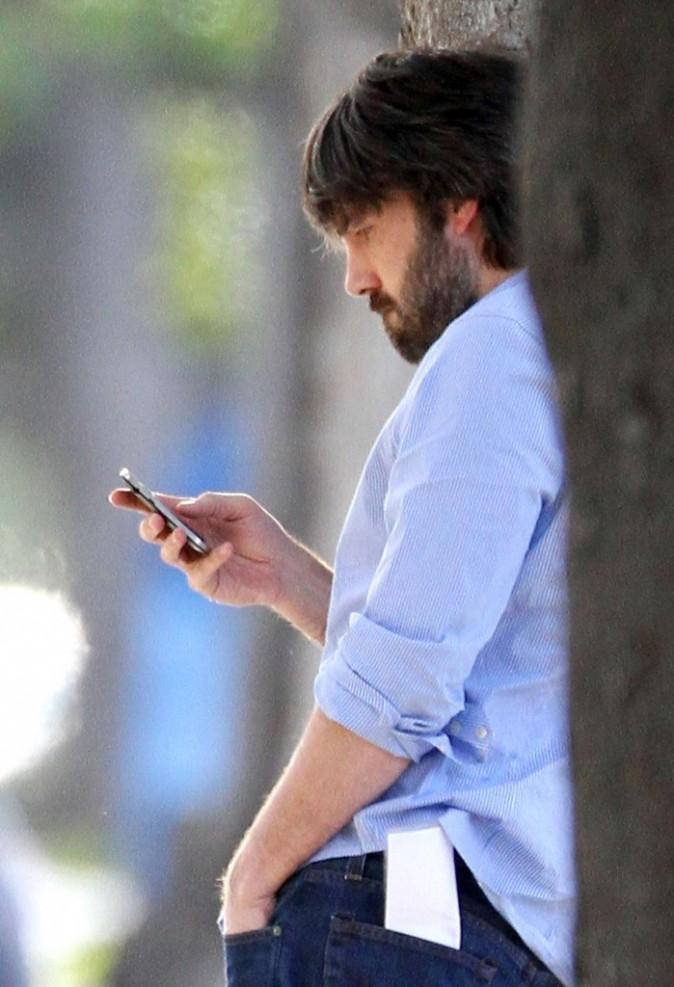 Il textote en attendant la sonnerie !
