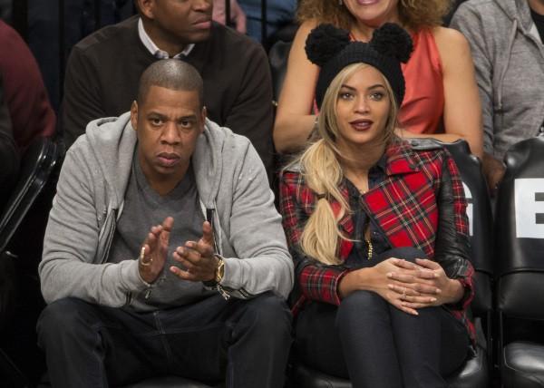 Jay-Z et Beyoncé lors d'un match de basket à New York, le 3 février 2014.