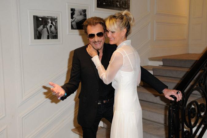 Johnny Hallyday et Laeticia Hallyday arrivant au défilé Christian Dior pendant la Fashion Week Haute Couture le 4 Juin 2016 à Paris