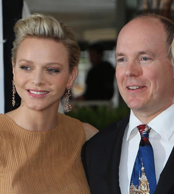 Charlene et Albert de Monaco à un défilé de charité le 25 mai 2012