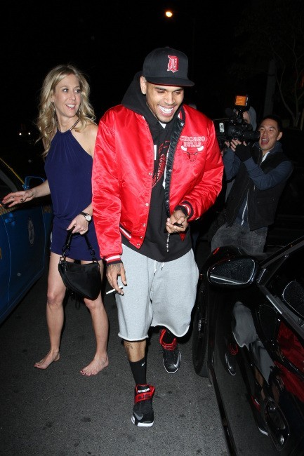 Chris Brown et une jolie blonde à la sortie du Bootsy Bellows à Los Angeles, le 20 janvier 2013.