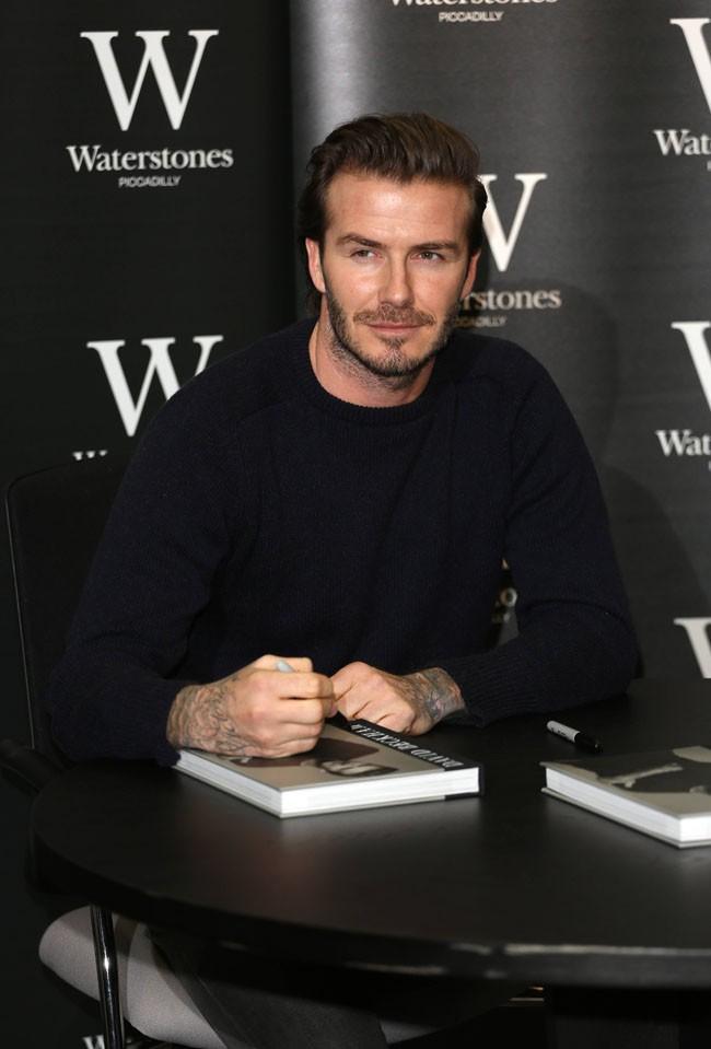 David Beckham en séance de dédicaces à Londres le 19 décembre 2013