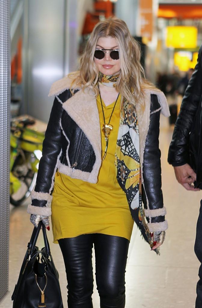 Fergie et Josh Duhamel à l'aéroport de Londres le 19 février 2013