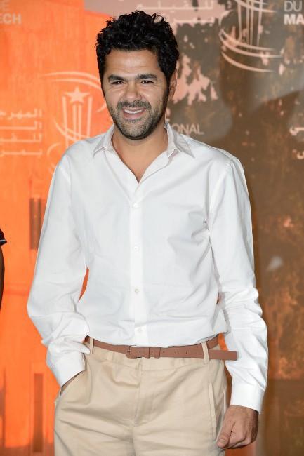 """Jamel Debbouze lors du photocall du film """"La Marche"""" à Marrakech, le 1er décembre 2013."""