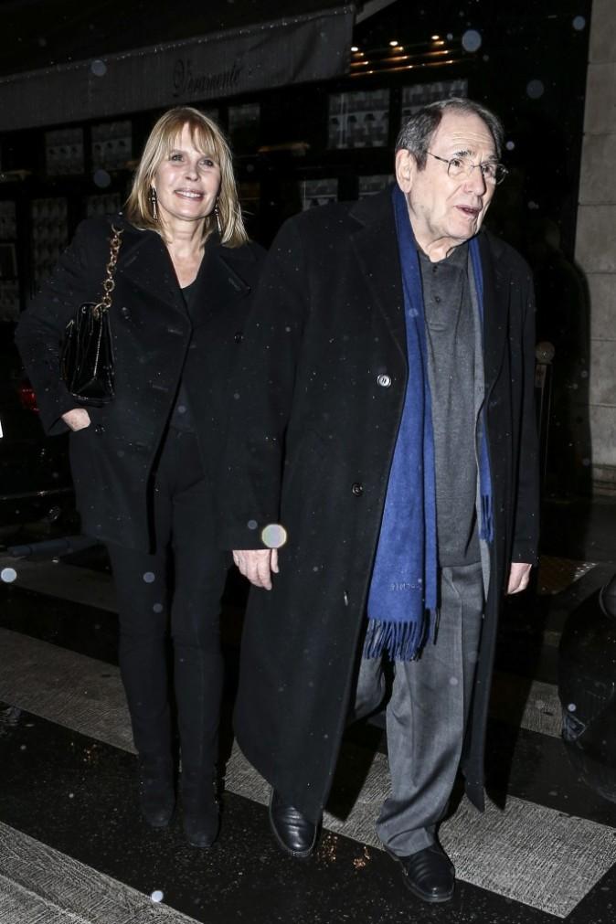 Robert Hossein et sa femme à l'anniversaire de Jean-Paul Belmondo, le 9 avril 2013 à Paris