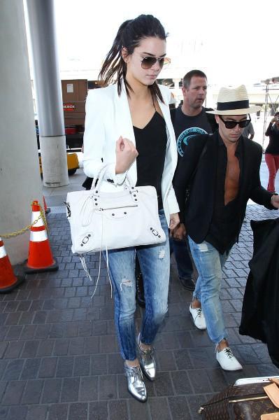 Kendall Jenner en route pour Paris, le 19 mai 2014.