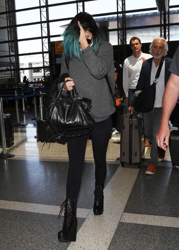 Kylie Jenner en route pour Paris, le 19 mai 2014.