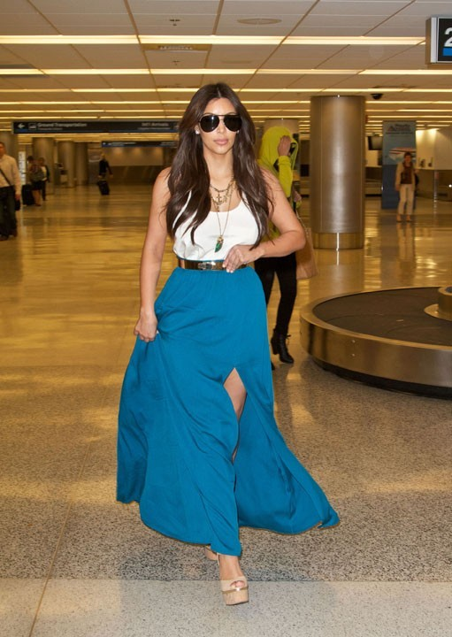 En tenue estivale pour son arrivée à Miami...