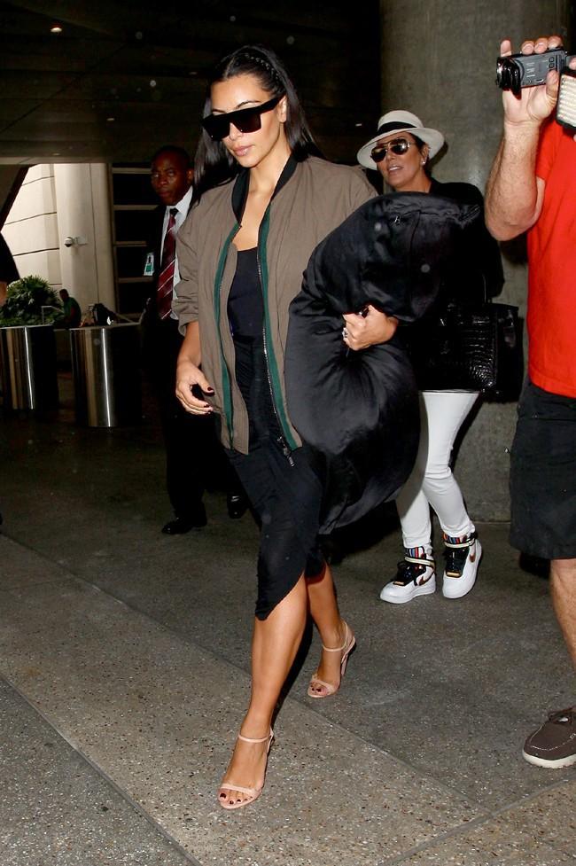 Kris Jenner et Kim Kardashian à l'aéroport de Los Angeles le 2 août 2014