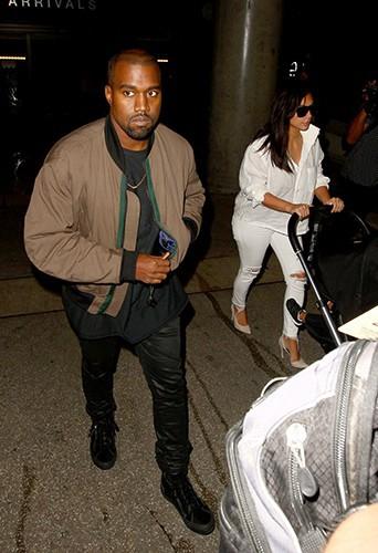 Kim Kardashian et Kanye West à l'aéroport de Los Angeles le 16 septembre 2014