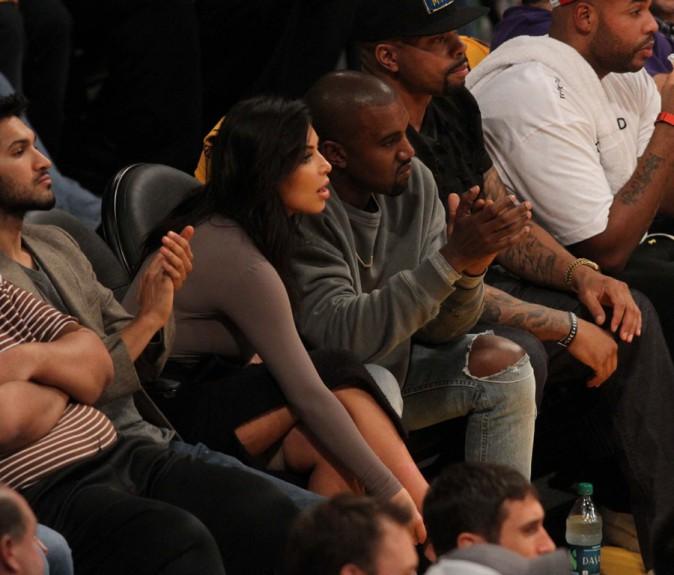Kim Kardashian et Kanye West au Staples Center de Los Angeles le 28 octobre 2014