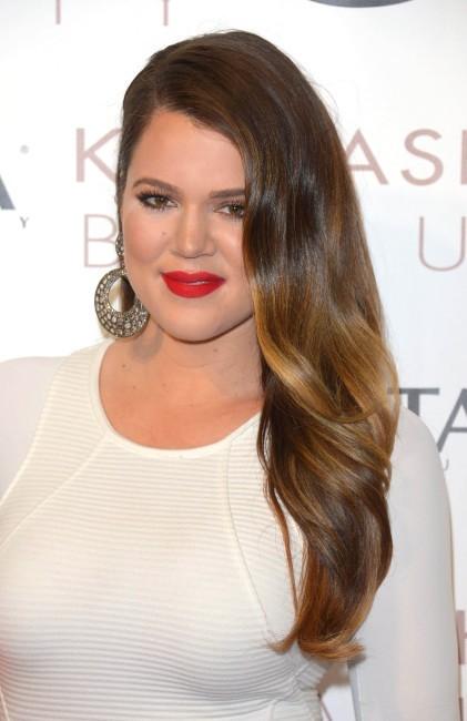"""Khloe Kardashian lors du lancement de leur ligne """"Kardashian Beauty"""" à Los Angeles, le 9 juin 2013."""