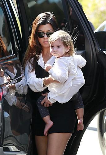 Kourtney Kardashian et Scott Disick en famille à Los Angeles le 9 mars 2014