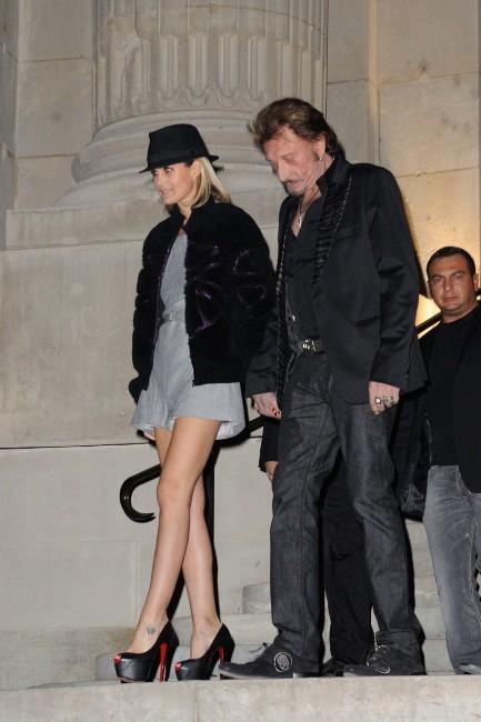 Laeticia et Johnny Hallyday quittant la soirée Chanel à Paris, le 8 novembre 2012.