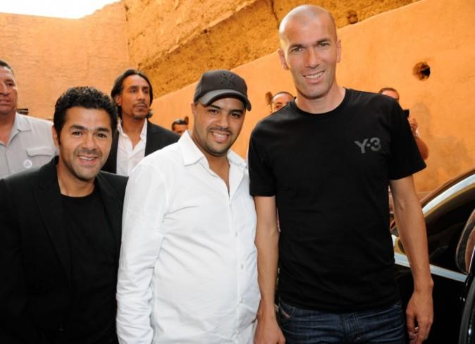 Jamel et Mohamed Debbouze, et Zinedine Zidane, lors du Festival Marrakech du rire, à Marrakech le 11 juin 2011.