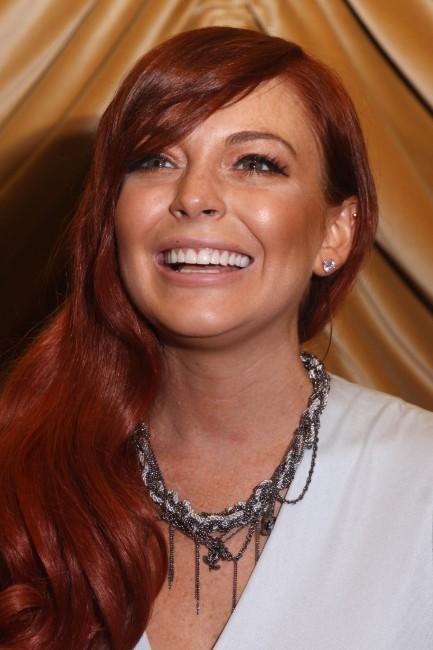 """Lindsay Lohan en promo pour le téléfilm """"Liz & Dick"""", le 18 octobre 2012."""
