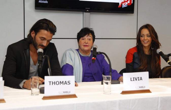 "Thomas Vergara, Livia et Nabilla Benattia lors de la conférence de presse de la télé-réalité ""Allo Nabilla"" à Paris, le 21 octobre 2013."