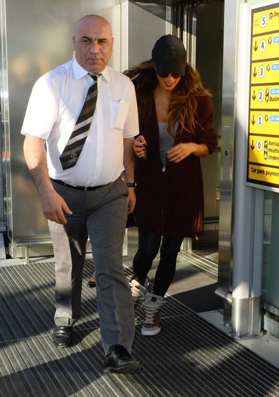 Nicole Scherzinger à l'aéroport d'Heathrow, le 16 mars 2014.