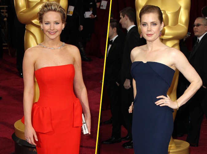 Jennifer Lawrence et Amy Adams lors de la 86e cérémonie des Oscars à Hollywood, le 2 mars 2014.