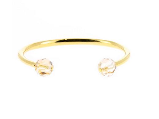 Un bracelet jonc en or jaune signé Les Interchangeables