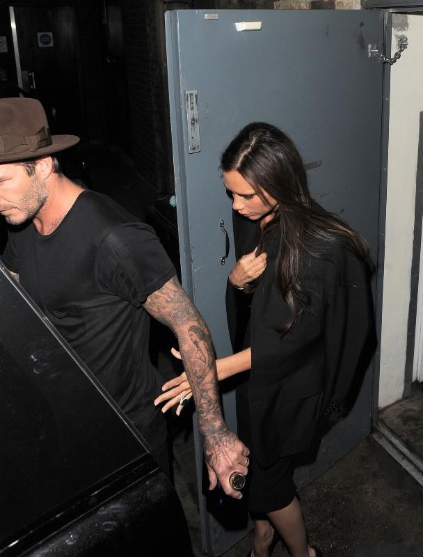 Victoria et David Beckham à la sortie du Arts Club à Londres, le 27 avril 2014.