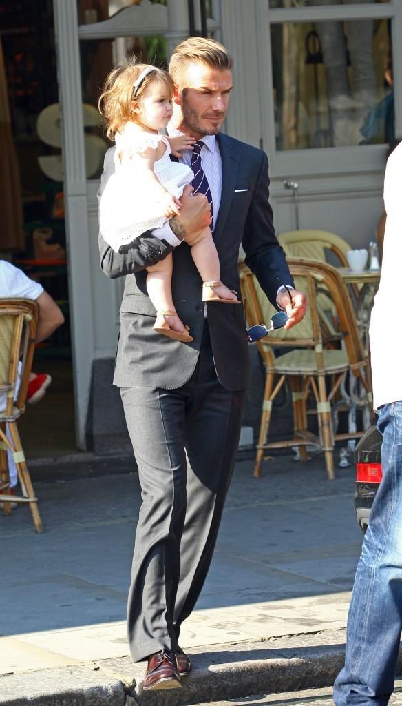 David Beckham et sa fille Harper à Londres, le 26 juillet 2012.