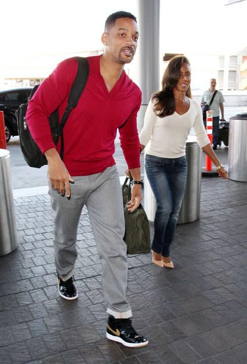 Will Smith et Jada Pinkett à l'aéroport de Los Angeles le 30 décembre 2013